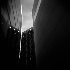 Within These Walls (dougchinnery.com) Tags: london film architecture modern contrast buildings holga skyscrapers lofi architectural