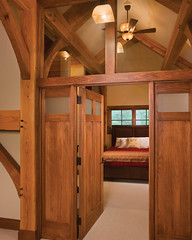 Timber Treasure Timber Frame Home - Master Bedroom (Riverbend Timber Framing) Tags: homes house mountain lake canada home beautiful architecture america design us cabin gallery exterior treasure unitedstates floor timber style northamerica pearl framing custom plans hybrid luxury riverbend cabins timberframe timberframehomedesign customhomedesign timberframeplans