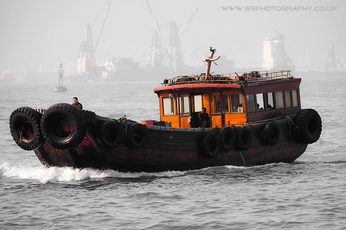 Old Boat Crossing Hong Kong Harbour