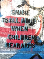 Shame to all adults when children bear arms (duncan) Tags: streetart stencils children stencil arms shame adults beararms shametoalladultswhenchildrenbeararms