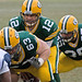 Scott Wells (63), Aaron Rodgers (12), Korey Hall (35)
