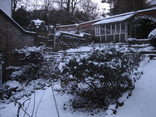 coachhouse in snow - garden