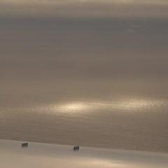 sun spots (tasawa69) Tags: ocean metal clouds airplane hawaii flying horizon wing