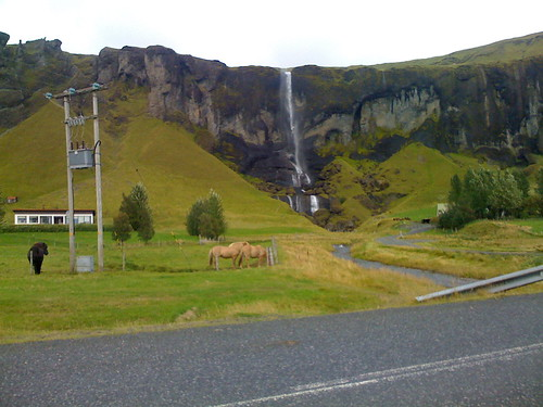 a random icelandic farm and waterfall