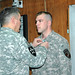 Brig. Gen. Gary Patton presents Army Staff Sgt. Randy Cunningham with a Joint Achievement Service Medal