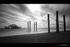 Left to the forces of nature (edmundlwk) Tags: uk longexposure sea england blackandwhite bw cloud abandoned beach water coast movement sand brighton jetty westpier shore canon7d tokina1116