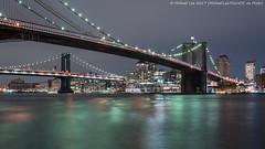 Two Bridges (20170210-DSC04310-Edit) (Michael.Lee.Pics.NYC) Tags: newyork twobridges eastriver brooklynbridge manhattanbridge southstreet fdrdrive pier17 seaport dumbo night longexposure composite lighttrails architecture clouds cityscape sony a7rm2 nikon nikkor50mmaf18d