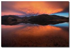 Say How You Feel (Sam Ili) Tags: light sky sun lake mountains color reflection water silhouette clouds sunrise canon landscape australia symmetry mount nsw dri kosciuszko kosciuszkonationalpark tumbarumba khancoban 450d australianphotographerscomp canon1022mm3545