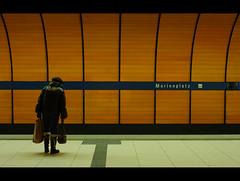 Waiting (It's Stefan) Tags: street grandma light people orange lines station linhas lady composition shopping germany underground walking subway munich mnchen bayern deutschland bavaria one metro geometry stage sub  tube grain step stop transportation ubahn alemania bags mrt granny heavy allemagne  gomtrie marienplatz germania halte lignes archtecture  parada lineas geometria   lneas arrt linien          geomerie publichtransportation    stefanhoechst stefanhchst stefanhoechst