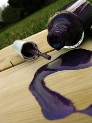 not on the deck (sfborin) Tags: wood grass outside site bottle purple violet indigo deck nails nailpolish grape seeping spillednailpolish stephanieborin blacklightexposure notonthedeck messypaperplain