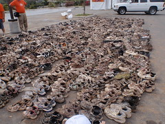 San Diego Mud Run - The shoes left behind to be cleaned and donated to Haiti. (Mr. Muddy Suitman) Tags: sandiegotrip