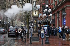Blowing Off Steam [Explored] (Clayton Perry Photoworks) Tags: vancouver bc canada downtown gastown rain explorebc explorecanada umbrella steamclock city