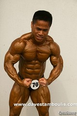 bodybuilder shows his muscles at a competition in Bangkok Thailand (jitenshaman) Tags: thailand muscle bangkok bodybuilding strong bodybuilder steroid