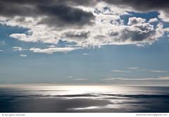 Entre dos cielos... (Nestor@INEDITT) Tags: sea sky water backlight clouds contrast reflections contraluz boat mar barco sailing nubes contraste sombras barquito velero benalmadena sailingboat retamar