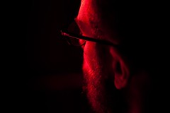 A man seen from behind (ale2000) Tags: red people man black canon beard rouge 50mm glasses noir candid uomo ear f18 rosso nero barba aznavour lightroom occhiali orecchio eos450d 450d zanicchi aledigangicom tilasciandare tutelaissealler