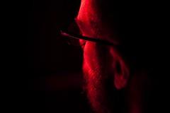 A man seen from behind (ale2000) Tags: red people man black canon beard rouge 50mm glasses noir candid uomo ear f18 rosso nero barba aznavour lightroom occhiali orecchio eos450d 450d zanicchi aledigangicom tilasciandare tutelaissealler