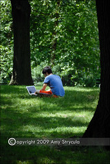 Young Man With Laptop In The Park By Astrycula
