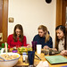 Students living in the intentional community house, Selah house, pray together before they share supper together.