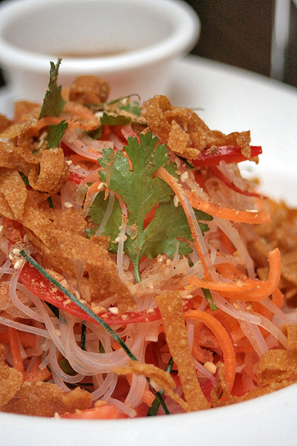 Raw salmon yu sheng salad, individual portion
