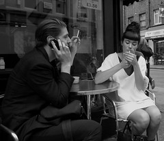 un jour comme un autre (Ian Brumpton) Tags: street uk england urban blackandwhite bw blancoynegro blackwhite couple candid soho streetphotography streetlife monochromatic londres angleterre valentinesday xanadu wardourstreet londonist sidewalkstories smokingwomen urbandreams 60slook londonstreetphotography unjourcommeunautre scattidistrada neroameta aimlessstrolling blackwhiteheartbeats