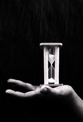 only time.. (dream_maze) Tags: light black dark flow sand hand darkness time finger fingers palm hours concept conceptual enya hourglass onlytime extendedpalm