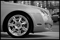 Bentley Continental GT (Eric Flexyourhead) Tags: bw canada detail car vancouver blackwhite downtown bc britishcolumbia continental gt bentley bentleycontinentalgt zd 50mmmacro20 50mmmacrof20 fairmontpacificrim olympuse3