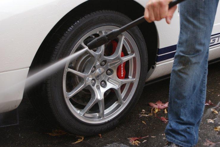 GT wheels being rinsed off
