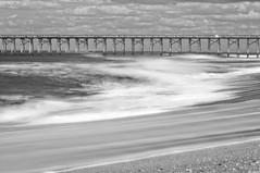 Atlantic Surf (NIKON 505) Tags: ocean blackandwhite blancoynegro beach grey coast pier blackwhite nikon surf waves north northcarolina stormy carolina slowexposure nikonslr d90 dayatthebeach neutraldensity 70200mm28 nd110 carolinacoast nikkor70200mmf28vr nikond90