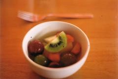 bowl of fruit (dom roarty) Tags: white fruit dessert iso200 strawberry fork bowl grapes kiwi olympusom1 kodakfilm