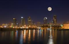 Leaving Port (Lee Sie) Tags: city moon reflection water skyline marina lights bay harbor pier dock marine cityscape sandiego fullmoon reflectionslovers