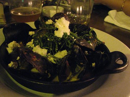 Brick-roasted mussels with basil, house-made sriracha, white wine & feta