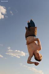 Tumbling in the Sky (naturalturn) Tags: shirtless usa man michael jump jumping nevada trampoline burningman blackrockcity esplanade leap 2009 leaping burningman2009 image:rating=4 image:id=080717