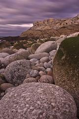 cantos rodados (migueltorrente) Tags: ocean sunset sea espaa marina landscape atardecer mar spain corua rocks stones sigma paisaje boulders galicia 1020 rocas piedras oceano cantos rodados
