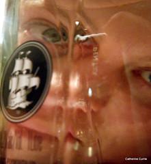 Reflections of a sprirt (LPM) Tags: portrait distortion selfportrait eye glass bottle pentax blueeyes australia victoria refraction gin distort plymouthgin mothersruin genieinabottle throughabottle