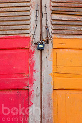 Locked door | Kandal Province, Cambodia (bokehcambodia) Tags: door red orange house detail building architecture asian temple pagoda wooden asia cambodia closed cambodian khmer close lock entrance monastery shutters wat padlock locked entry
