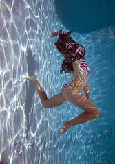 Fluidity (lindilindi) Tags: blue woman water pool girl female ga pose underwater stripes suit bikini bathing kellie flexible hawaiimelindapodorlindilindicopyrightdonotusewithoutpermission gettyinvited