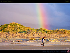 Running Under The Rainbow (tomraven) Tags: light sunset sky sun beach rain clouds children geotagged rainbow sand running nov25 piggyback mywinners flickrdiamond fbdg tomraven q409 aravenimage geo:lat=40731208 geo:lon=175117993