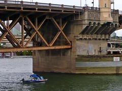 Big Bridge, Little Boat (AntyDiluvian) Tags: bridge oregon river portland boat pacificnorthwest steelbridge drawbridge powerboat willametteriver girder outboard 5photosaday