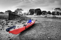 The Lonely Kayak (iamNigelMorris) Tags: ocean life red color beach water sand nikon kayak connecticut paddle rocky jacket shore selective