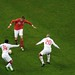 Sayed Moawad and Wael Gomaa try to stop Peter Crouch's pass to Shaun Wright-Phillips