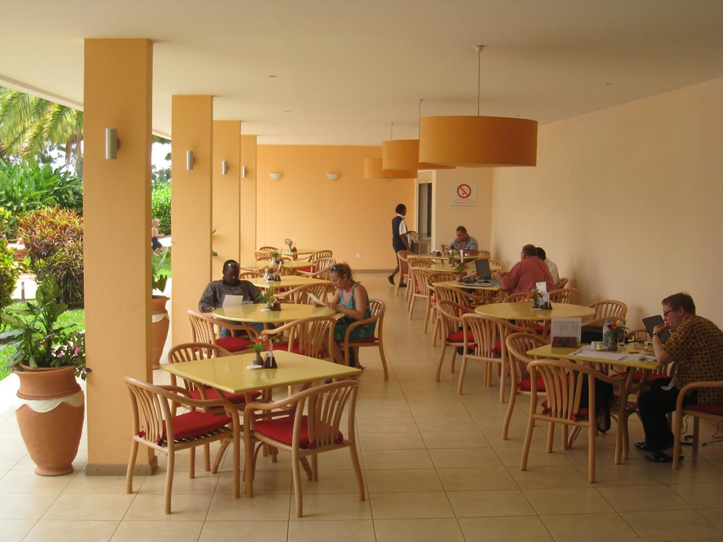 photo essay welcome to hotel rwanda the poolside dining area kristin luna and william our driver are sitting to