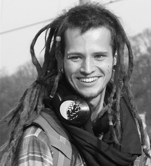 DREADS + PIERCINGS (Akbar Simonse) Tags: street portrait people urban bw holland blancoynegro netherlands smile zwartwit candid streetphotography denhaag x bn piercings dreads portret thehague streetshot straat studentenprotest straatfotografie straatfoto dedoka akbarsimonse