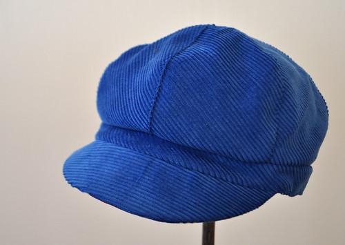 blue newsboy