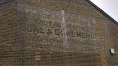 Chertsey 19 February 2017 002 (paul_appleyard) Tags: ghost sign cartage agent lswr coal coke merchant contractor for household removals chertsey surrey