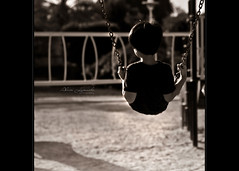 in the shadow of your wings (alvin lamucho ) Tags: light boy blackandwhite playing playground sepia vintage gladness happy kid shadows child bokeh joy middleeast son monotone swing jed kuwait 50mmf14 backview psalm rimlight rebelt1i alvinlamucho arylljed