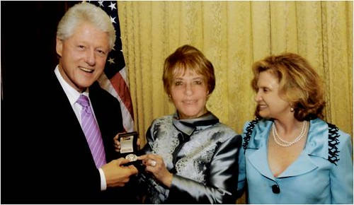 Loula with President Bill Clinton and Congressmember Carolyn B, Maloney.