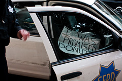 I Was Promised Donuts (Rubin 110) Tags: california sign us unitedstates protest police sfpd lightroom policecruiser ef28mmf18usm canoneosdigitalrebelxsi iwaspromiseddonuts