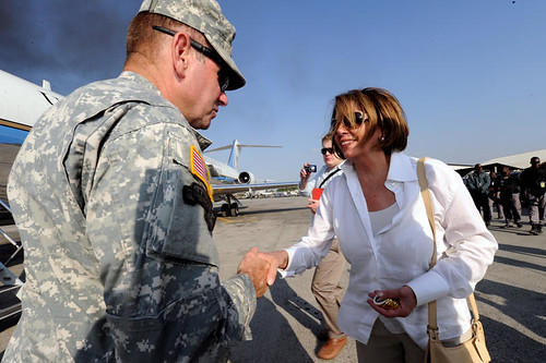 During a Congressional delegation to Haiti, U.S. Rep. Nancy Pelosi give