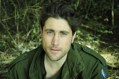 Me (Jonathan Kos-Read) Tags: leaves forest soldier eyes blueeyes innocent young greentint