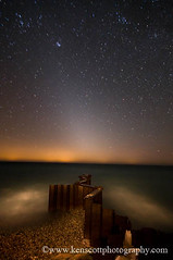 Pt Betsie breakwall under last nights Zodiacal light . . . (Ken Scott) Tags: winter usa lighthouse ice beach spring sand waves michigan lakemichigan greatlakes zodiacallight ptbetsie nearthe45thparallel kenscottphotography kenscottphotographycom